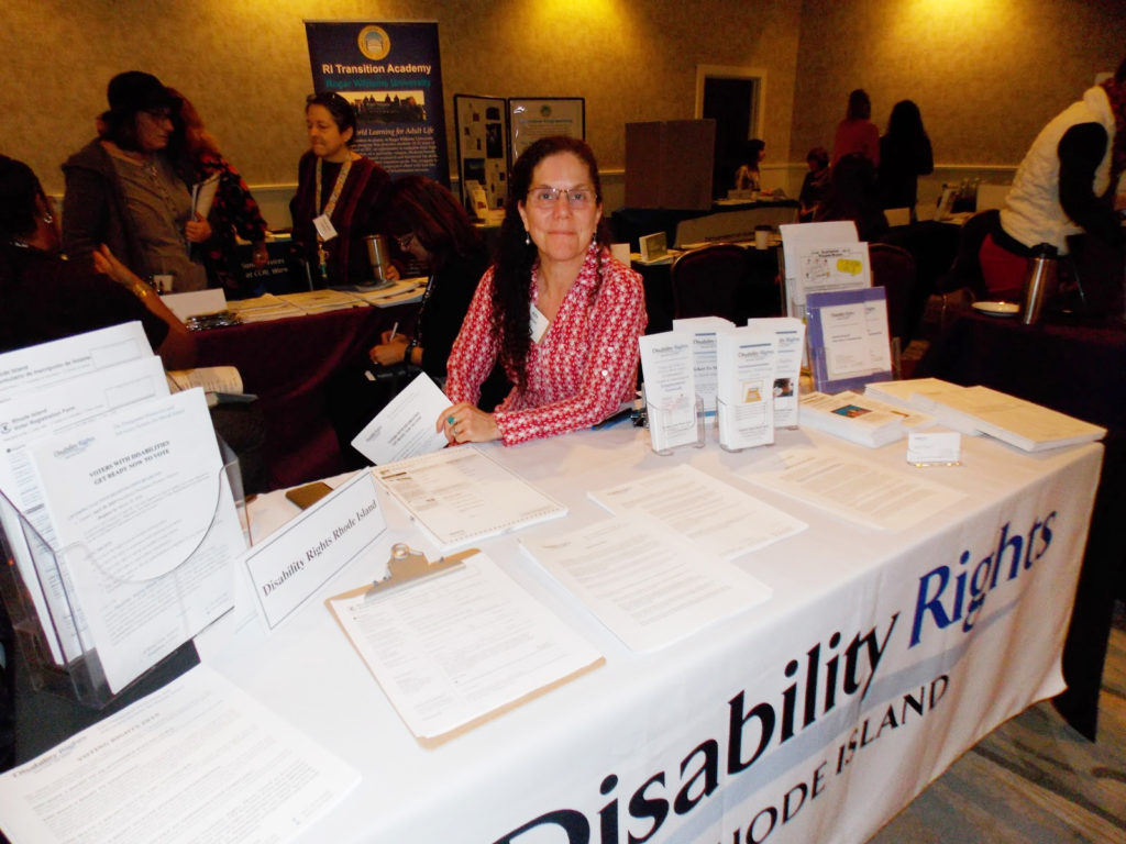 Kate Bowden from DRRI at a display table during an event
