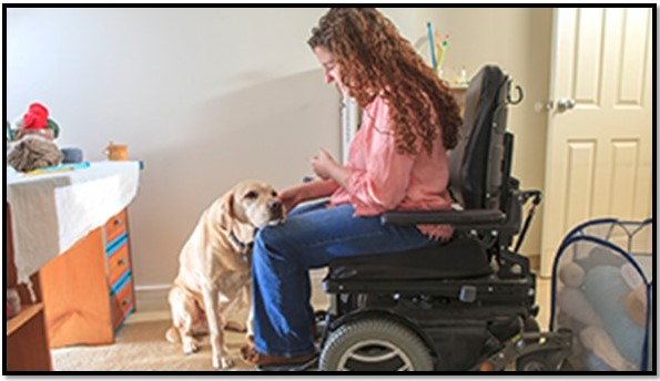 Woman in electric wheelchair with a dog